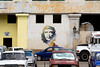 "A portrait of Ernesto ""Che"" Guevara appears on the wall of a Havana port facility."