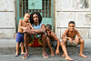 "A ""Rasta"" and three kids in Santiago loving the camera.  Great smile on the right."