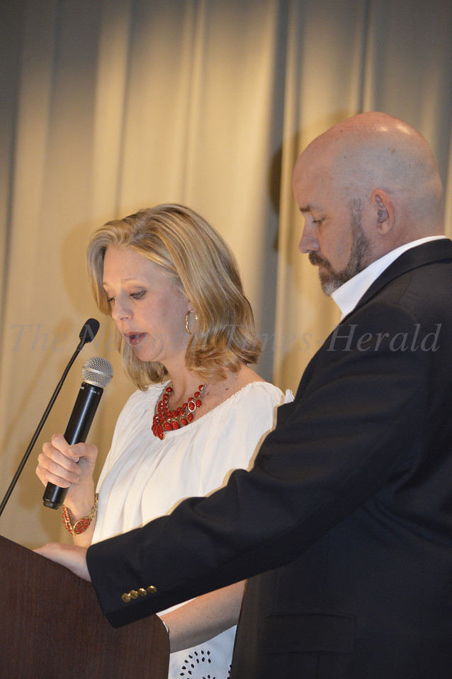 Photo By Maggie Bowers<br /> Christi and Rob Estes give the welcoming speech at the Grey Matters Dinner Event benefitting the couple's nonprofit organization, Can't Never Could.