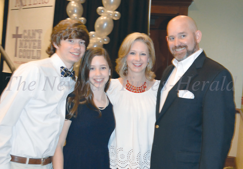 Photo By Maggie Bowers<br /> The Estes family gathers for a photo at Grey Matters Dinner Event benefitting the local nonprofit, Can't Never Could.