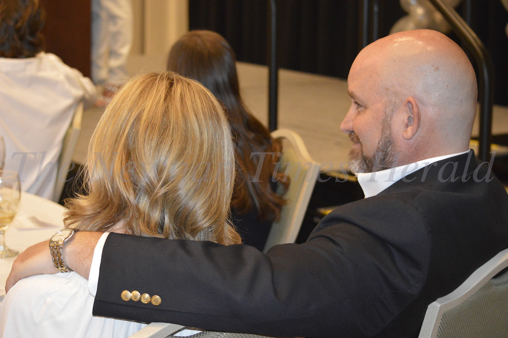 Photo By Maggie Bowers<br /> Rob and Christi Estes watch keynote speaker, Denise Jackson.