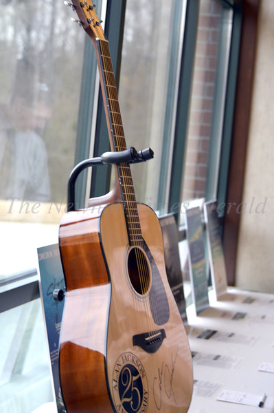 Photo By Maggie Bowers<br /> A guitar signed by country music star Alan Jackson was offered for silent auction during the Grey Matters Dinner Event.