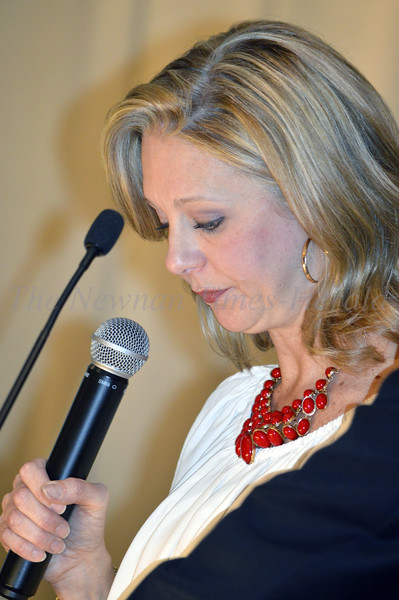 Photo By Maggie Bowers<br /> Christi Estes pauses during the couple's openening speech at the Grey Matters Dinner Event benefitting Can't Never Could.