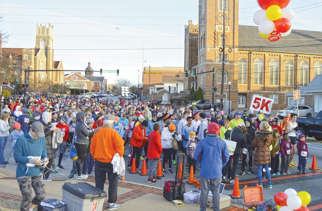 Photo by Maggie Bowers<br /> Hundreds of participants gather for downtown Newnan's annual Run for Angels race Saturday.