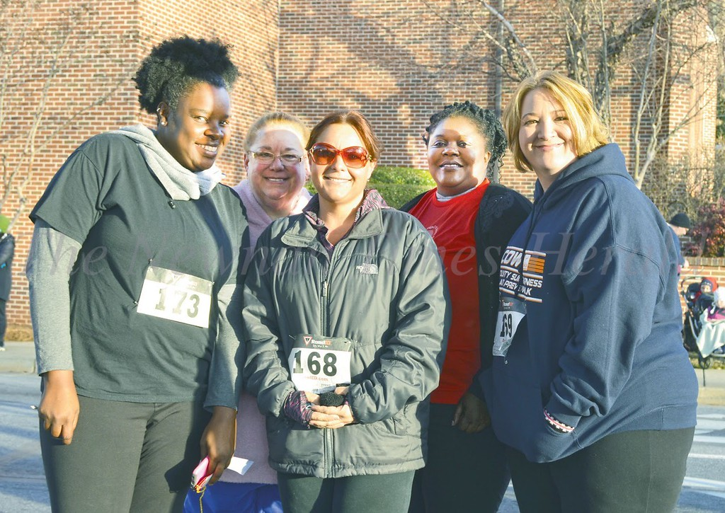 Photo by Maggie Bowers<br /> Participants meet and great after the one-mile run, the first of three races that are part of the Run for Angels held early Saturday in downtown Newnan. From left are Verbeth China, Sherry Fouts, Julie Fouts, Charlisa Rogers, and Tracie Hicks.