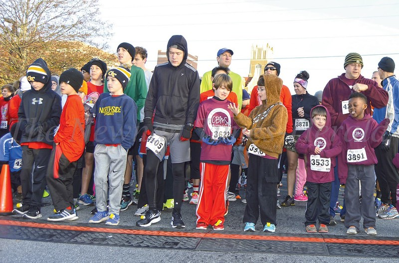 Photo by Maggie Bowers<br /> Young runners wait patiently at the starting line for the 5K portion of the Run for Angels held in Newnan Saturday morning.