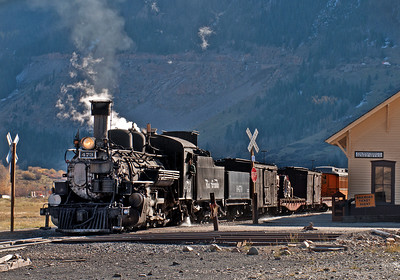 October 6, 2016.  The Silverton mixed pulls past the Silverton depot late in the afternoon.