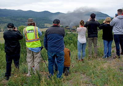 August 25, 2018.  Photo line along the road just west of Cresco.   Jim Wrinn of Trains magazine has his safety vest on.  In the distance the chartered freight approaches the stretch of track known as Orgasm for the many derailments caused by moisture and soft track.