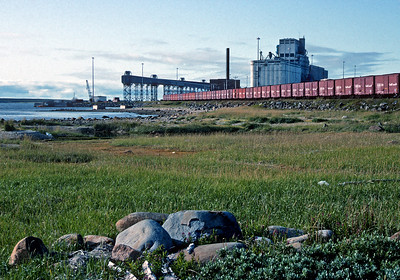 September 1992.  The Churchill water front on Hudson Bay.  This is the farthest point north reached by the contiguous North American rail system.  In years pas the longest rail train you could take in North America was from Churchill to La Union in El Salvador.  Today you can get only as far as Tapachula, Mexico.  And the line from Churchill is no very much at risk of abandonment.