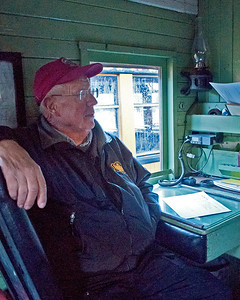October 7, 2016.  Photo organizer Dave Gross appropriately occupies the conductor's seat in the caboose of our mixed train.
