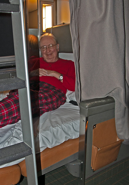 An  occupied section ready for a good night's sleep.  Bill Bradshaw is prepared to enjoy a good nights sleep in the widest berth in a traditional sleeping car.  March 2017.