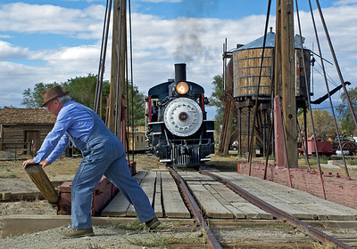 "Retired Southern Pacific Conductor ""Bo"" Golson lines up the turntable at Laws."