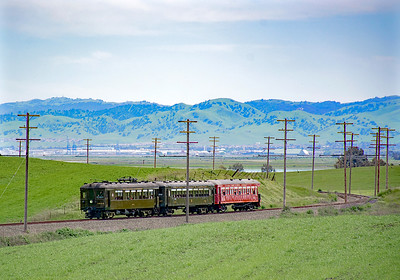 April 13, 2019.  Heading north from Birds Landing.  In the background is the confluence of the Sacramento and San Joaquin rivers were they flow into Suisun Bay, and the SN operated a car ferry to get to the Oakland end of the line.  After a wet winter the hillsides are emerald green, within a month or so it will be turning summer brown.