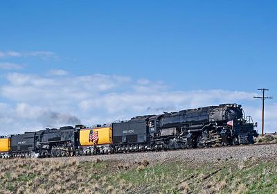 May 13, 2019.  Leroy Road, Wyoming.  Well, I was hoping for a bit more exhaust.  This location is nowhere near a town, but I counted about 100 cars and one bus parked waiting for the train.
