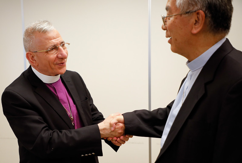 The Bishop Dr. Munib Younan, left, greets Catholic Archbishop Joseph Mitsuaki Takami  before delivering an address on ecumenism and Lutheran-Catholic dialogue at St. Ignatius Catholic Church in Tokyo, Japan on Monday afternoon 24 July, 2017. About 125 people attended the event. Photo by Ben Gray / ELCJHL