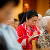 A woman takes notes as Bishop Dr. Munib Younan speaks about ecumenism and Lutheran-Catholic dialogue at St. Ignatius Catholic Church in Tokyo, Japan on Monday afternoon 24 July, 2017. About 125 people attended the event. Photo by Ben Gray / ELCJHL