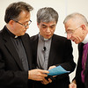 The Bishop Dr. Munib Younan, right, goes over program notes with Lutheran ReverendsTadahiro Tateyama, left, and Naoki Asano before delivering an address on ecumenism and Lutheran-Catholic dialogue at St. Ignatius Catholic Church in Tokyo, Japan on Monday afternoon 24 July, 2017. About 125 people attended the event. Photo by Ben Gray / ELCJHL