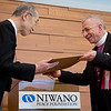 Bishop Dr. Munib Younan accepts the Niwano Peace Prize from the Rev. Nichiko Niwano during a ceremony Thursday morning 27 July, 2017 in Tokyo Japan. Photo by Ben Gray / ELCJHL