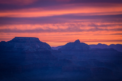 A Grand sunrise. Dawn from Yavapai point, smoke resembles fog in the canyon