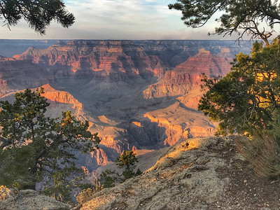 An evening walk along the south rim, and the smoke seems to have cleared, though one can see the source still burning on the north rim.
