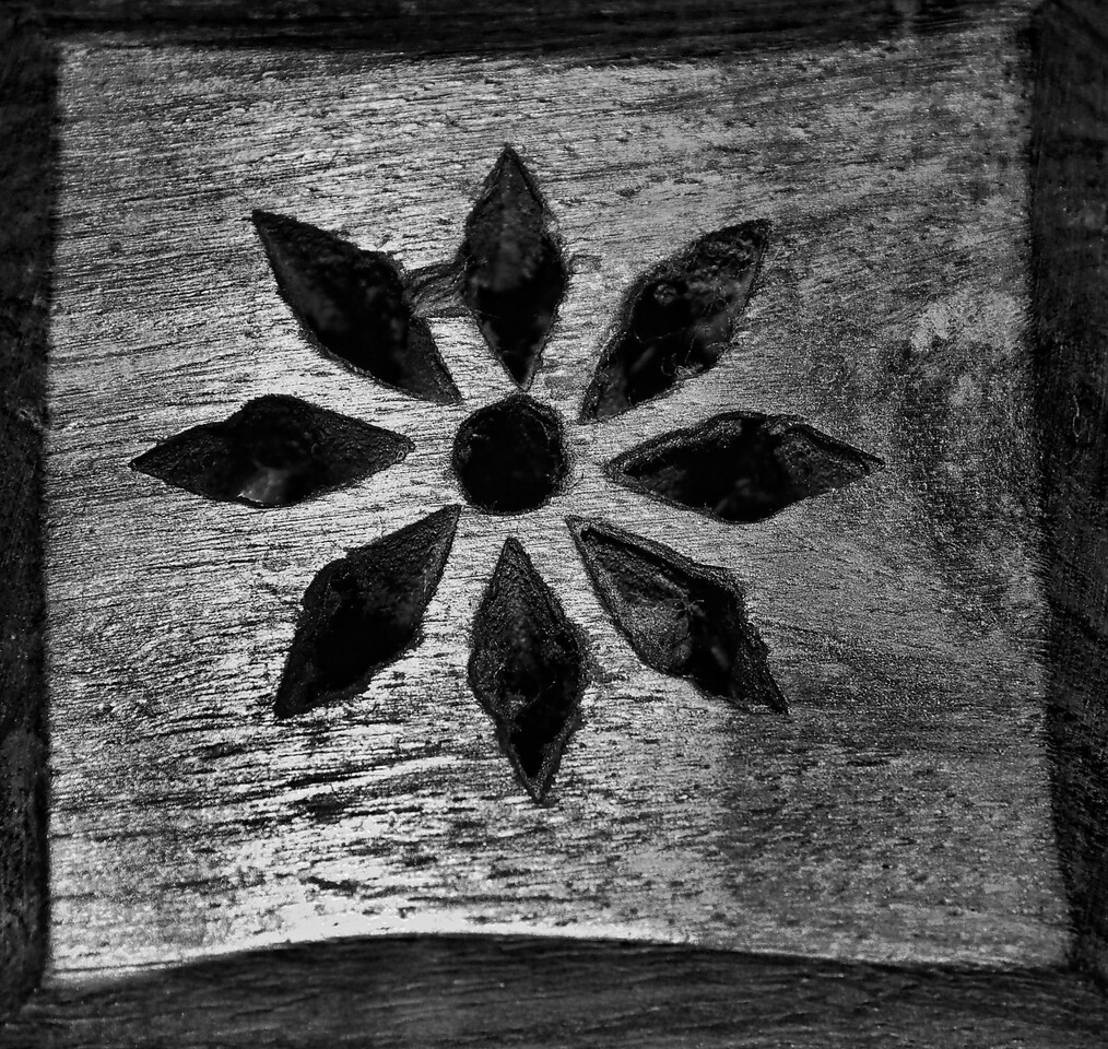 "08-16-2012 ""Wood Star""<br /> <br /> Simply overlooked most of the time, this caught my eye one night.  Once I started looking at it, I started to think about who made it, and how... was it difficult?  Was it just part of the routine of someone to carve these holes in the wood? Or was it made with some extra measure of dedication?<br /> <br /> Questions which will go unanswered..."