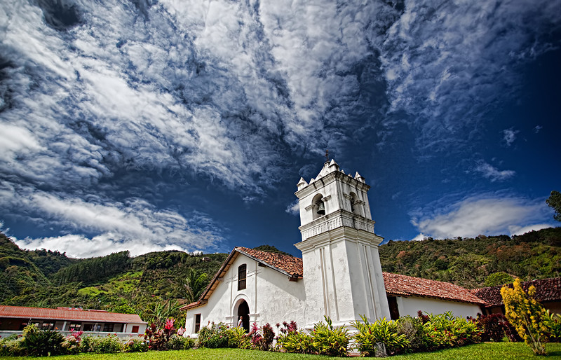 "03-11-2012: ""Divine Moment""<br /> <br /> The Orosi colonial church has been standing on this place for 278 years (as of the time of this picture)... the light and the clouds seem to converge on the bell tower and grant the scene something special..."