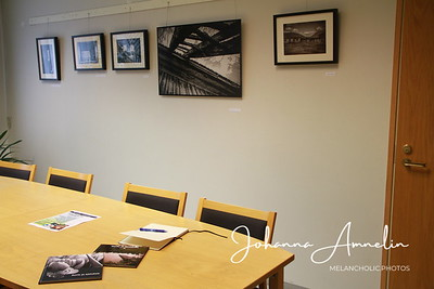 Framed ones are printed on glossy photo paper, the big one is printed on aluminum plastic composite