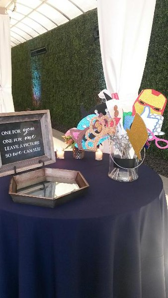 I like the prop sign the bride set up with the mirrored tray!
