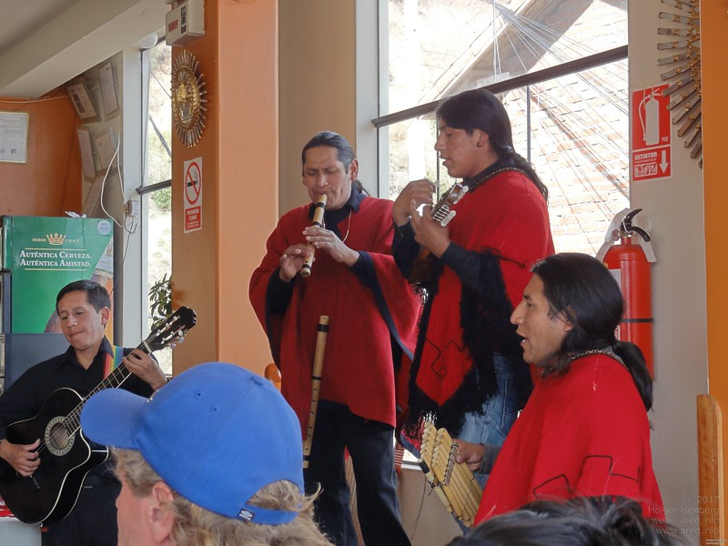 One of the many musicians in Cusco's restaurants with the original Peruvian quena pipe and the siku, the double row pan flute.