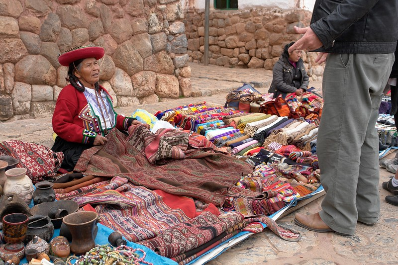 Not Cusco, but Chinchero. Those high quality textiles with natural dyes are rare and one of the large cloths is about $100. The very bright colors are always synthetic dyes.