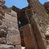 Pisac. Different styles of masonry, but I don't see any reason to claim that it was built in different stages. Those are just different type of stones and the transition to the more simple construction is fluent, not a division by culture.