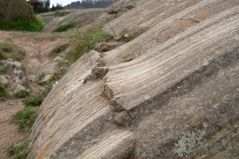 Those detailed traces give a hint of the natural creation process: It was extruded in a lava like flowing state through a pattern shaping hole in other rocks.