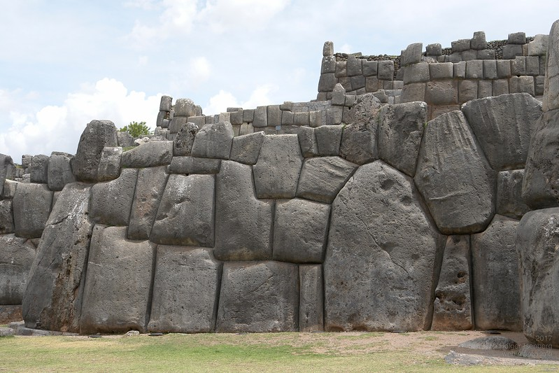 Sacsayhuaman. The technology used to shape those natural hard limestone rocks is still unknown. At least they had to soften the stones to create those perfect jointless fittings without mortar. Other possibility: Nature provided plasticine like shapable stone for a short time span. The hidden contact surfaces between the stones within the wall are mostly perfect fits without any filling or space in between. You find the exact same construction technology in the oldest Egyptian temples like in Giza and Abydos. That's different to Greek or Roman mortarless walls where the hidden stones surfaces are of concave shape with only the edges touching (anathyrosis).