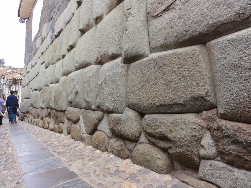 Different type of megalithic wall built like all of those type without any mortar. The stones are more irregular, but you cannot fit a razor blade in the joints. The hidden contact surfaces between the stones within the wall are mostly perfect fits without any filling or space in between. You find the exact same construction technology in the oldest Egyptian temples like in Giza and Abydos. That's different to Greek or Roman mortarless walls where the hidden stones surfaces are of concave shape with only the edges touching (anathyrosis).