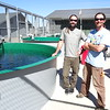 Cushman Fish Facilities Manager Andrew Ollenburg (left) and Assistant Manager Brian Lundeen rear sockeye salmon at the Saltwater Park Sockeye Hatchery.