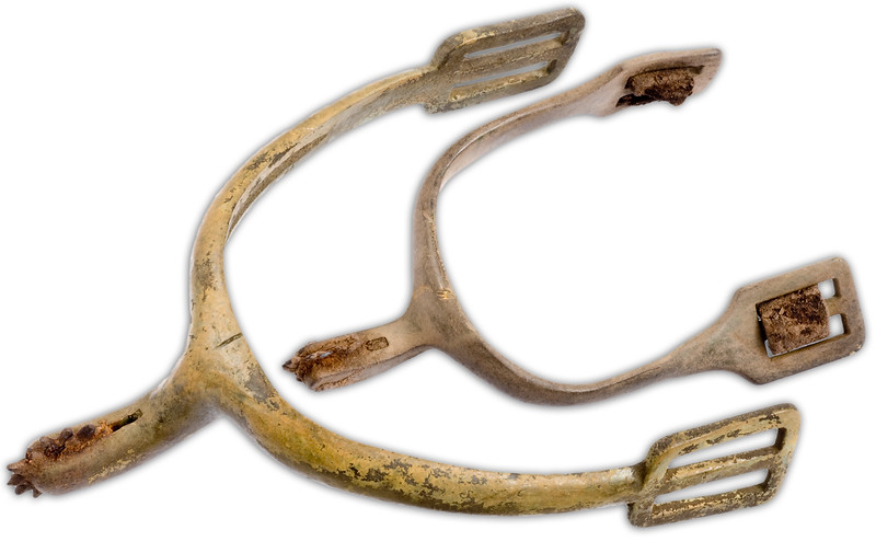Two cavalry spurs of different sizes.