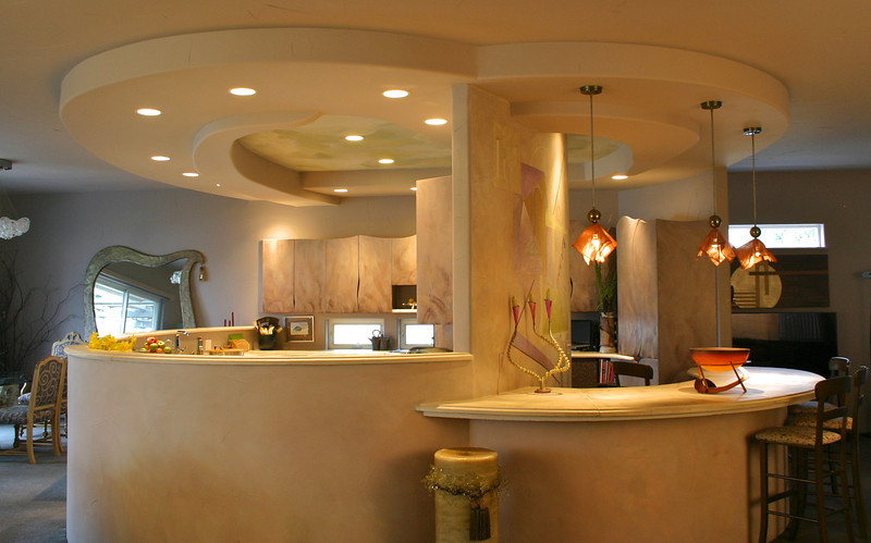 The kitchen and bar are like an island in a large living space.
