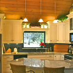 The tops of the cabinets with their soft LED lights, create great places for some homey decorating.