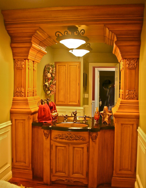 "Notice how the mirror is ""famed"" by the cabinetry."