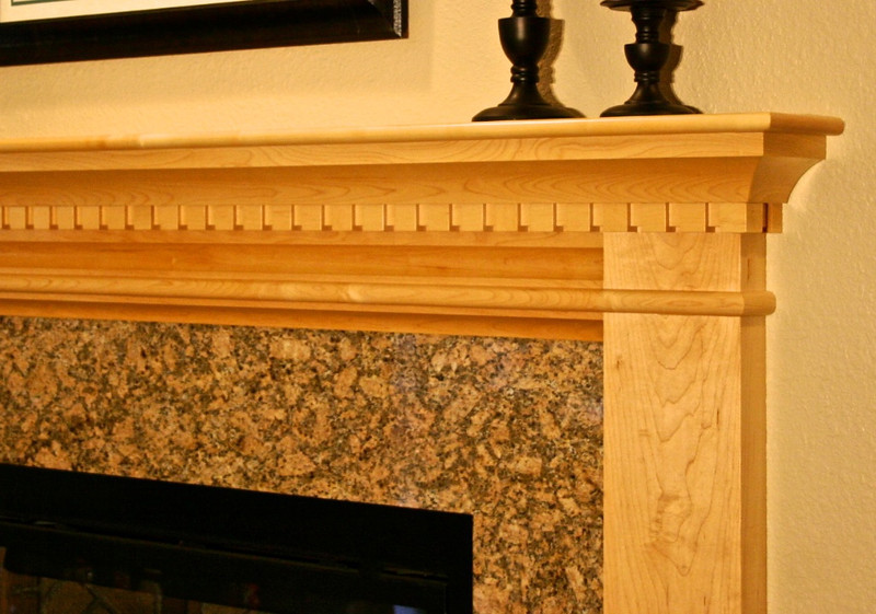 Extra detailing in the mantle tends to make it better fit the character of the living room.