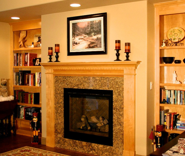 Across from the kitchen, we made a mantle that complements the rest of the cabinetry