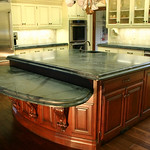 The countertops and sink are made from an exquisite green soapstone.