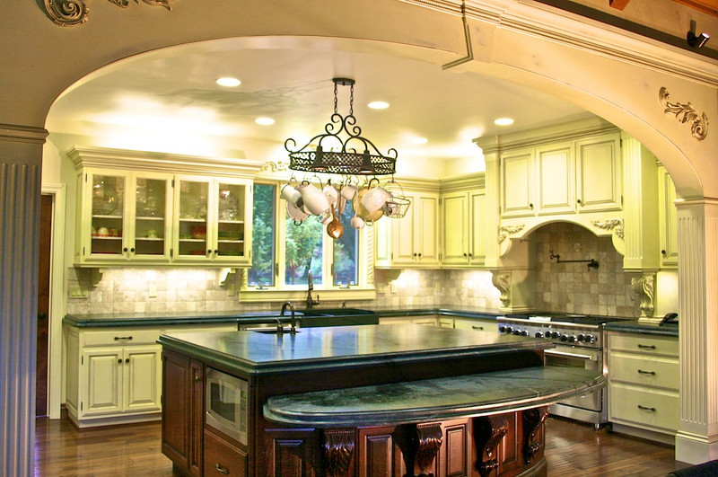 To elegantly frame the view of the kitchen from a large living room, we created a large elliptical arch.