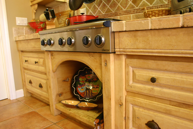 The perimeter cabinets are knotty alder to which we naturally accelerated the aging process. All the aprons are fully functional drawers; a specialty of Woodgrain Woodworks.