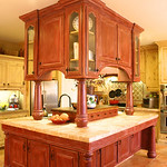 The upper cabinetry of the island gives it a gregarious, grand quality.