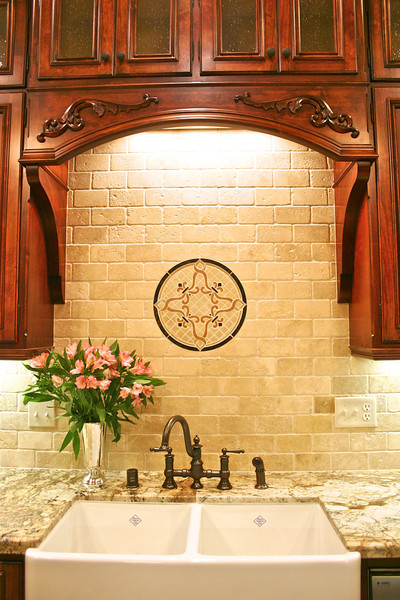 A decorative light valance in this windowless sink area, added some much needed cheer.