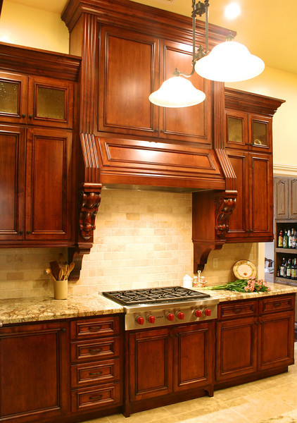 Giving it generous proportions, we took the hood cabinet all the way to the lofty ceiling, making it the major focal point of the kitchen.