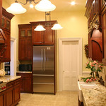 Having five doors and no windows, with cabinets on all four walls, certainly keeps it in the tradition of kitchens of this period.