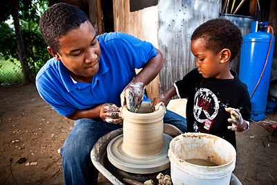 Dad and son working together, Kingston, Jamaica