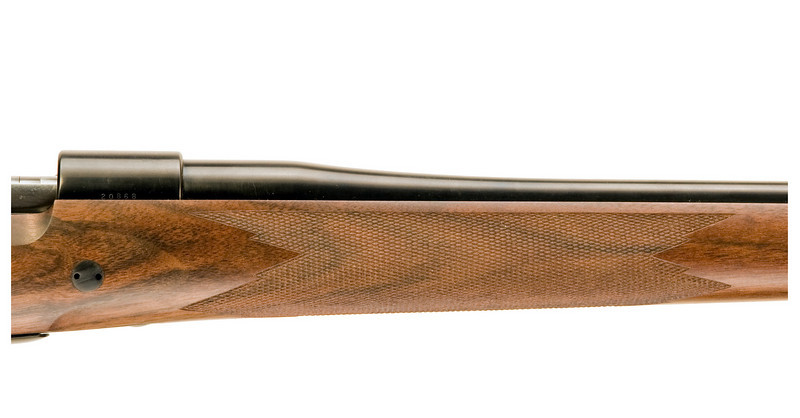 Right side view of the forend showing the cross bolt and forend checkering.